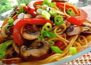 asian noodle salad with mushrooms, peppers, onions, and noodles for lunch time
