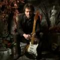 Drew Nelson seated with Stratocaster Portrait by Derek R. Audette