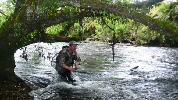Johnny Groome following a fish on the Arnold River, West Coast, South Island, NZ