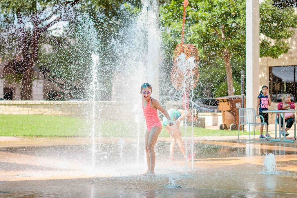 Girl playing in splash pad
