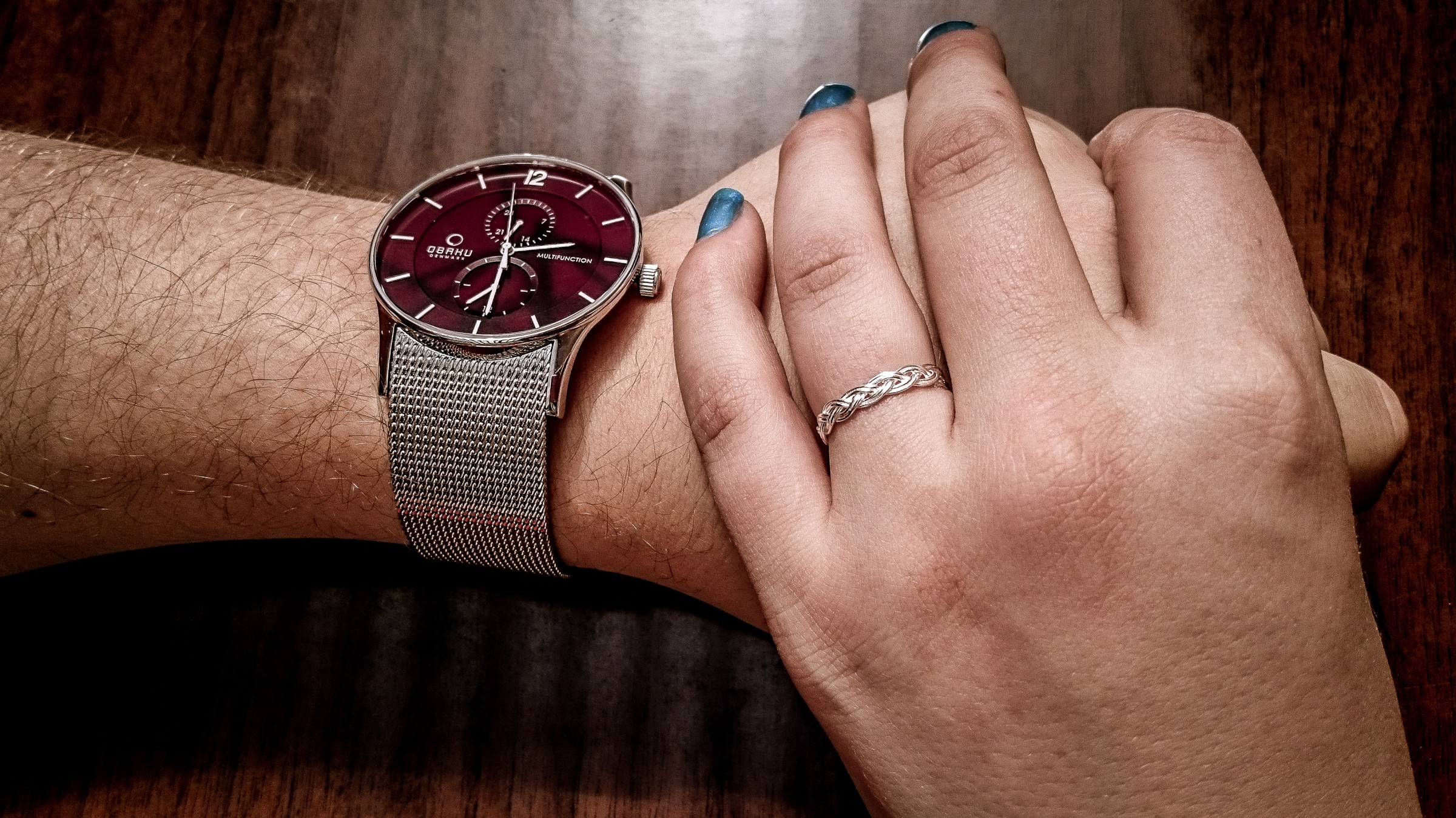 Holding hands with watch and ring