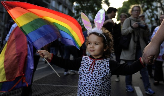 A girl holds a Rainbow flag of the LGBT movement during the XXI Gay Pride Parade, at Mayo square in Buenos Aires on November 10, 2012. AFP PHOTO / Alejandro PAGNI (Photo credit should read ALEJANDRO PAGNI/AFP/Getty Images)