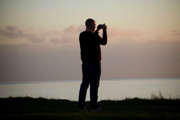 Photographer on clifftop 2