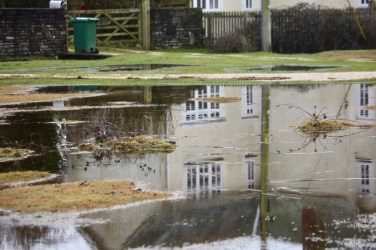 House reflected in pool 1