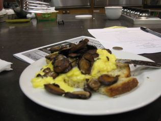 Toast with scrambled eggs and mushrooms