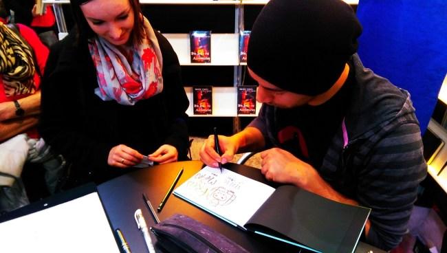 Rudy Eizenhöfer signiert mit individuellen Zeichnungen