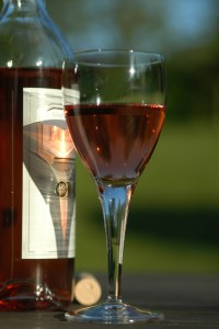 a glass of rose wine playing with the sun 2 1192416 - a-glass-of-rose-wine-playing-with-the-sun-2-1192416