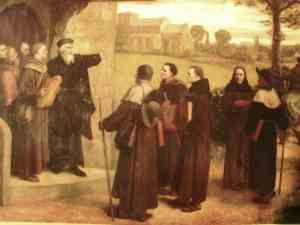 Wycliffe da a sus discípulos su traducción de la Biblia,  obra de William Frederick Yeames (Wikimedia).