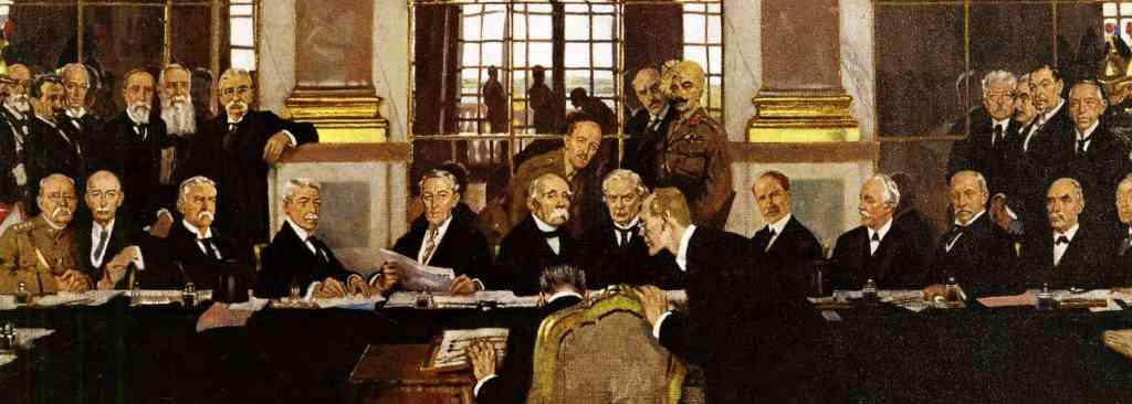Johannes Bell firma el Tratado de Versalles en la Galería de los Espejos (Wikimedia).
