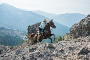 Crockett and Sara climbing Cougar Rock at the 2012 Tevis Cup.