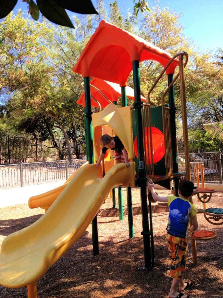 orange and yellow playground with two boys playing