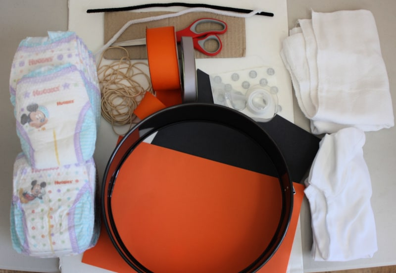 Supplies pictured for a Star Wars diaper cake