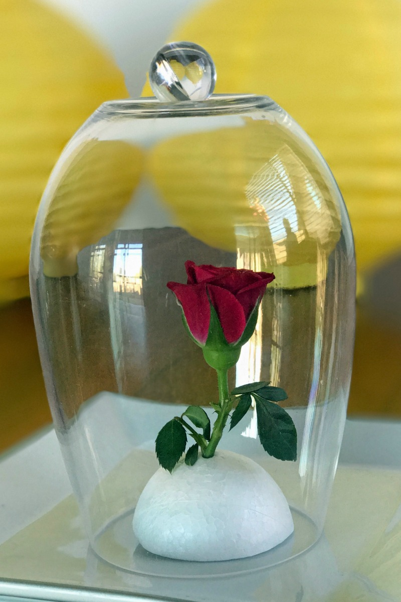 Enchanted rose in a DIY Plastic Bell Jar for a Beauty and Beast Party Favor Idea