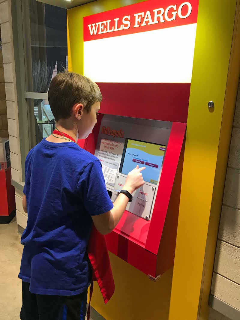 Working ATM at Sugar Land Children's Museum mini city and more things to do near Houston with kids