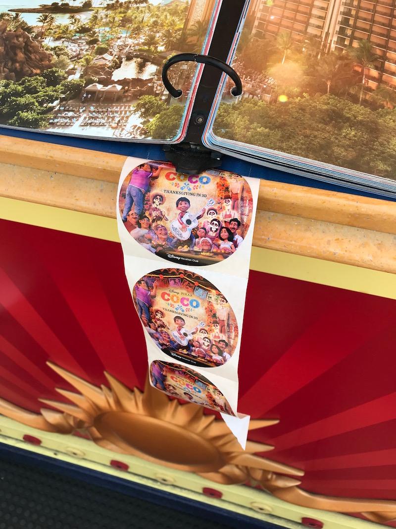Find a free Pixar sticker at a DVC booth during Pixar Fest Scavenger hunt at Disneyland