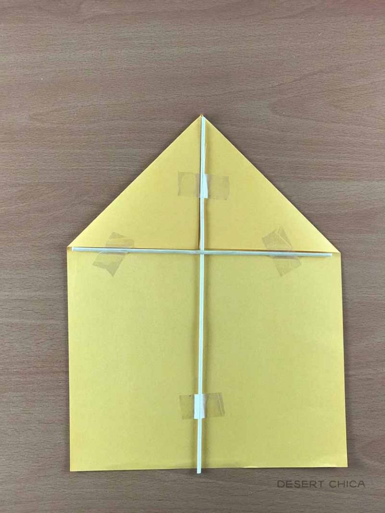 Add a smaller wood dowel under the folded corners when making a Mary Poppins Paper Kite