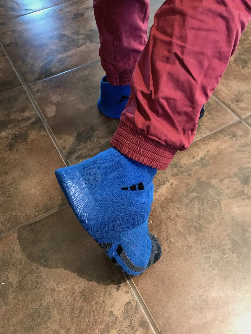blue socks over a pair of tennis shoes