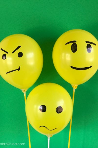 yellow balloons with faces drawn on them
