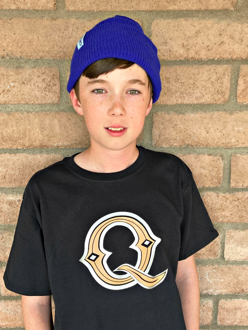 "Boy wearing black t-shirt with ""Q"" on it from Pixar Onward"