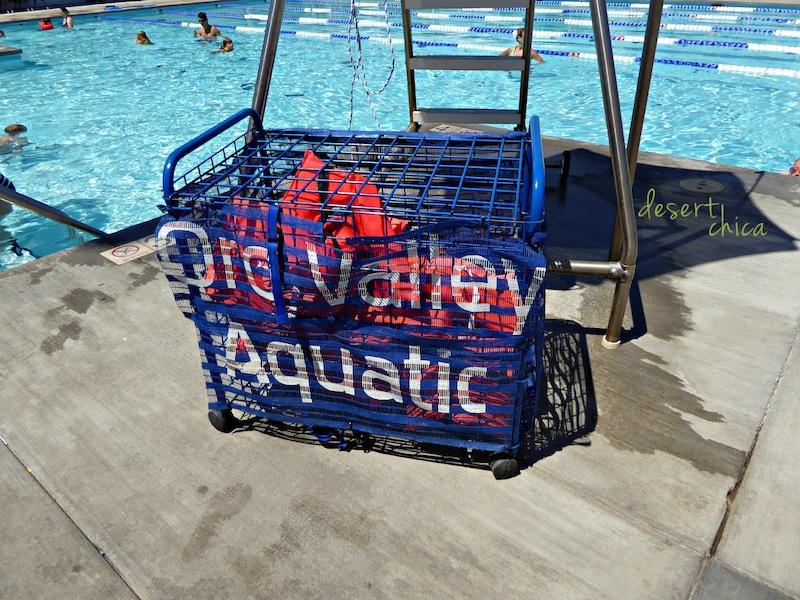 Basket of life vests at a pool