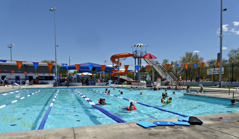 Swimming pool with water slide in background