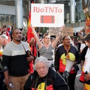 June 9, 2020, The Guardian. Protesters at a rally outside the Rio Tinto office in Perth Tuesday. Reconciliation Australia has withdrawn its endorsement of Rio Tinto as a reconciliation action partner after it detonated explosives in the Juukan Gorge in the Pilbara, destroying two ancient rock shelters. Photo Richard Wainwright/AAP