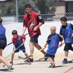 Louis Domingue playing ball hockey with kids