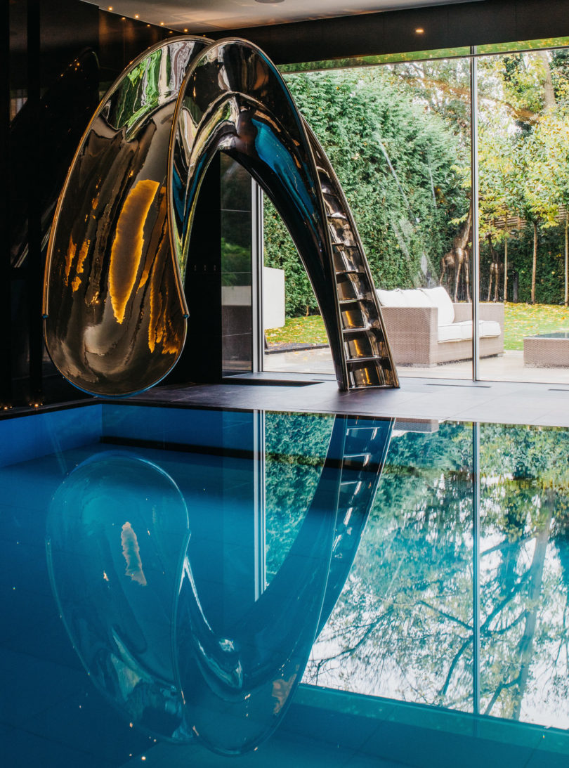 Sleek Sculptural Water Slides For The Modern Pool