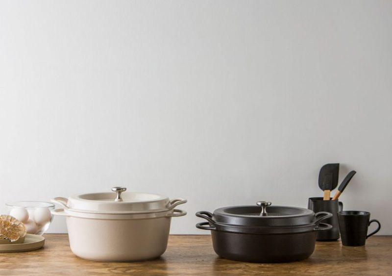 vermicular Japanese cast iron oven pot in black and white on a kitchen counter