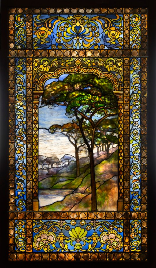 "Tiffany Studios, ""Landscape window,"" 1893-1920. Photo: John Faier, © The Richard H. Driehaus Museum."