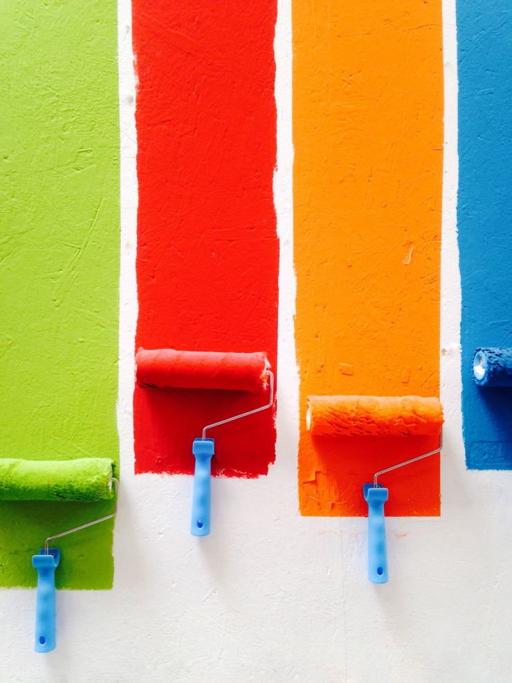 paint colors being rolled on a wall