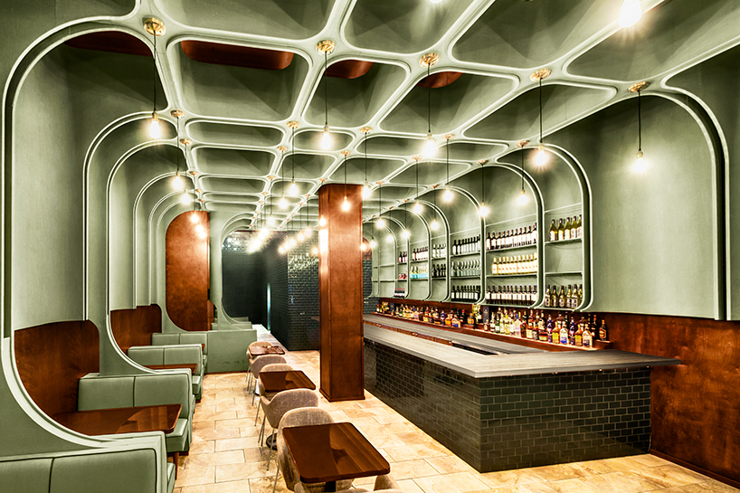 Bluarch Wraps Times Square Diner With Soft Green Interior