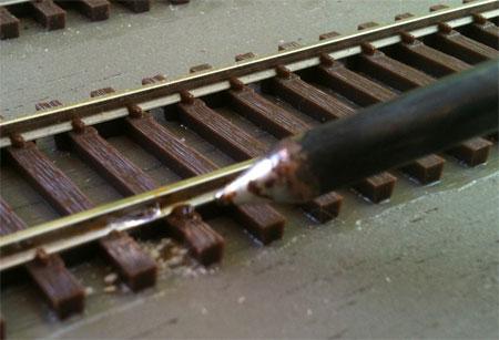 Tin the spot on the rail.