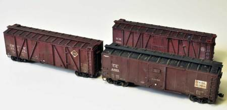 Weathered box cars that were displayed at an NMRA meeting.