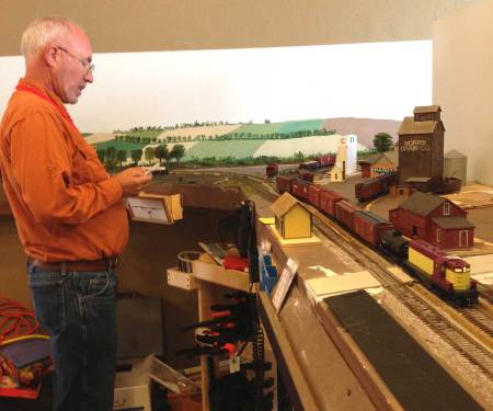 Ken pulls and spots the freight cars as he works the eastbound local.