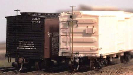 A comparison with a completed Roundhouse box car that was modified with new ends and other details.
