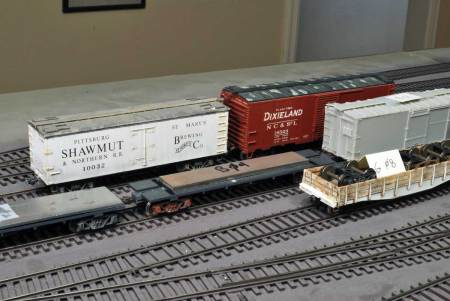 Note the tags on undecorated and partial freight cars. If it can roll and has working couplers, use them in your operating sessions!