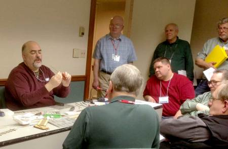 Dave Ramos (at left) demonstrates building turnouts with Fast Tracks tools at the 2014 RPM Valley Forge meet.