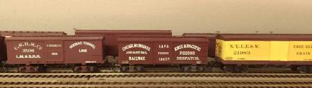 The USRS Co 28-foot box car at the left is scratchbuilt with Art Griffin decals applied. The CM&StP car 28-foot in the center is a modified B.T.S. (LINK: http://www.btsrr.com/ ) kit for a PRR box car. Art Griffin decals were applied for the final lettering. The colorful Erie car on the right is a Canfield and McGlone resin kit.