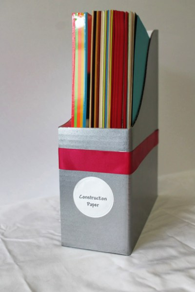 Here is a crazy easy DIY project for you. No talent required. Just upcycle magazine files or buy some cardboard magazine files, and add paint and ribbon to make them fabulous. #magazinefiles
