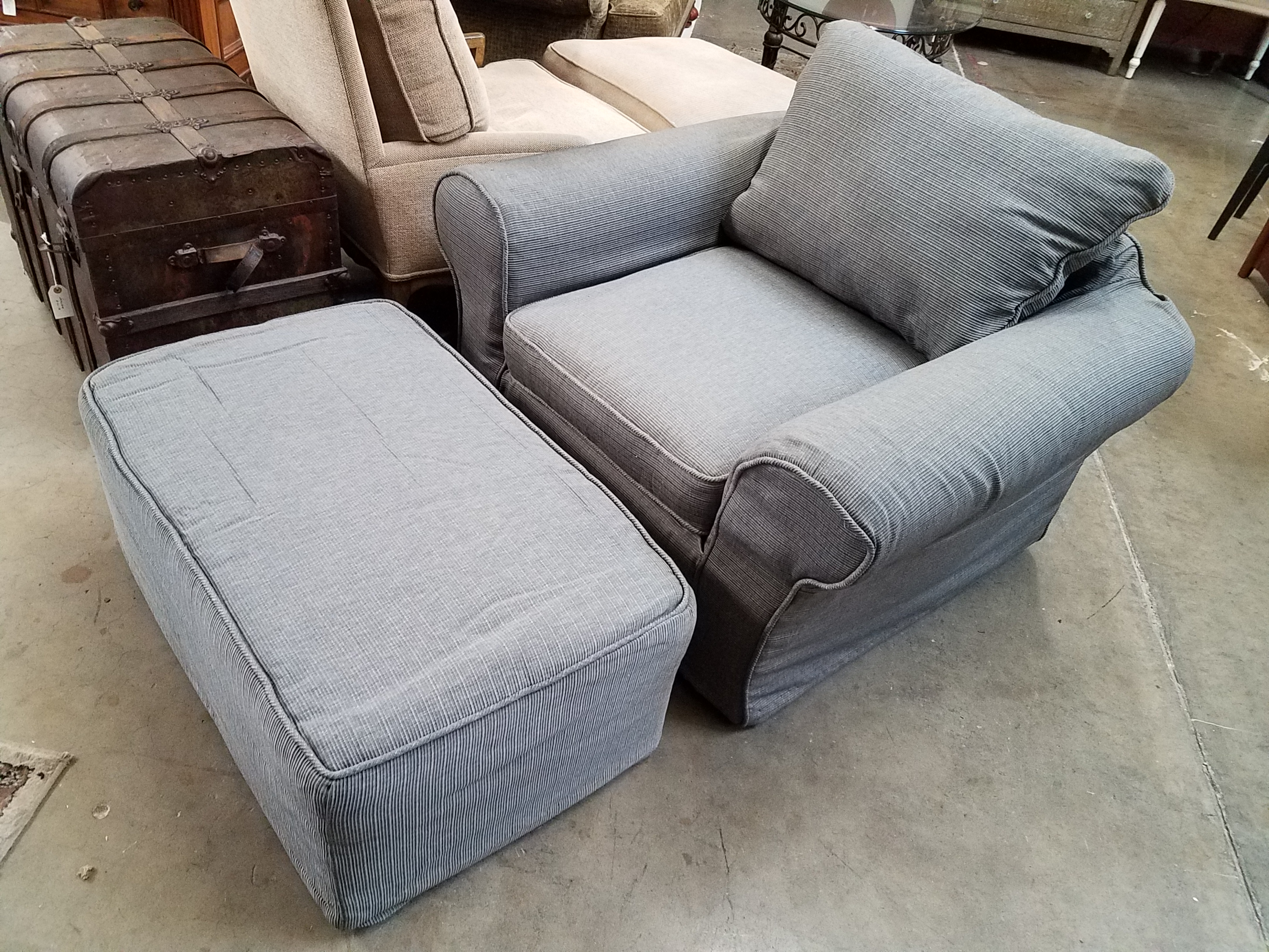 Gray Upholstered Lounge Chair And Ottoman