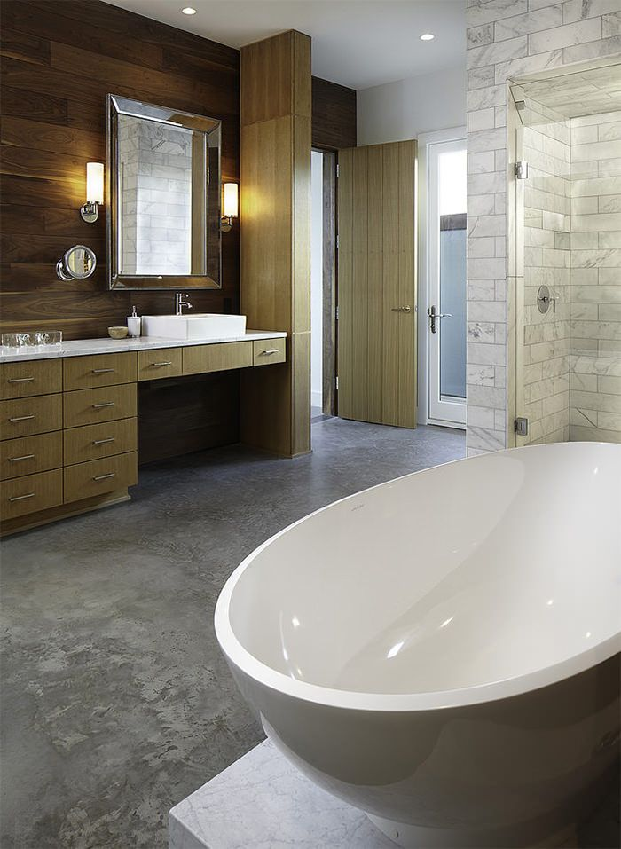 Banheiro sofisticado com piso em cimento queimado