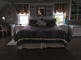 Custom headboard with matching night stands.