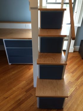 Stairs have pull out storage drawers.