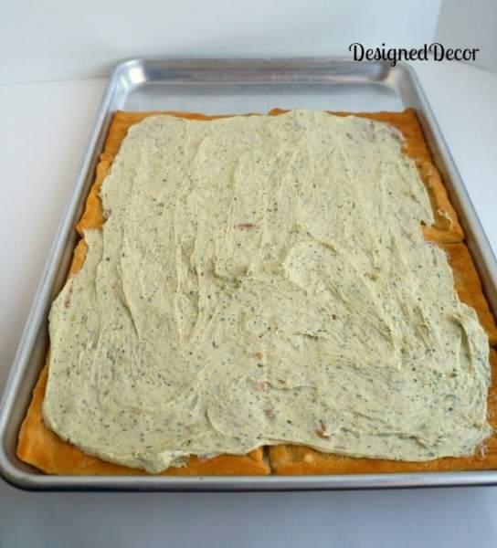 spreading the cream cheese layer