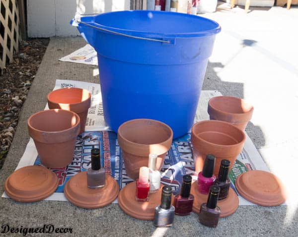 painting flower clay pots with nail polish