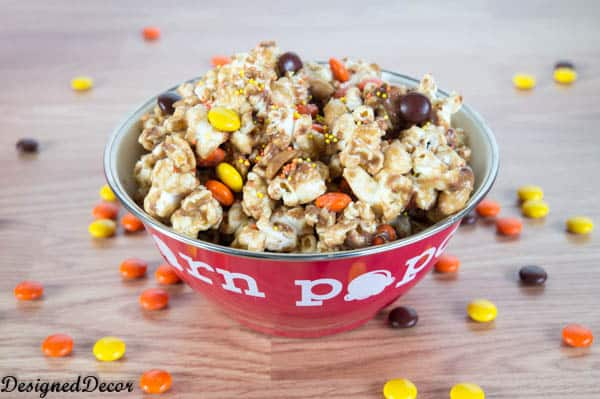 Peanut Butter Popcorn with Reese's pieces, Reese's mini cups and peanuts
