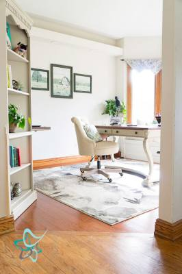 entryway view of a home office with desk and bay window