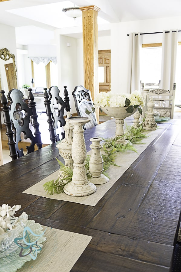 aged layered candlestick holders displayed on dining room table