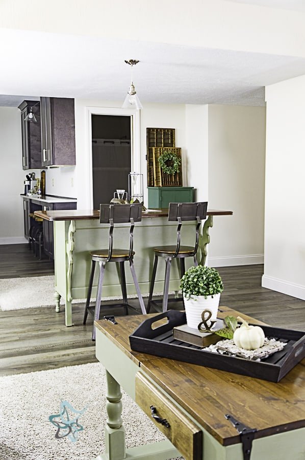 open concept living room and kitchen with a dresser converted to a kitchen island island